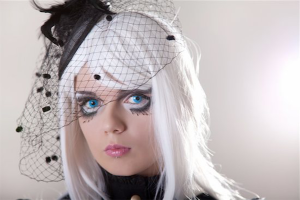 Halloween injuries: headshot of girl in costume with platinum hair and bright blue eyes wearing bird's nest veil