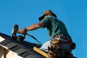 Photo of worker repairing a roof