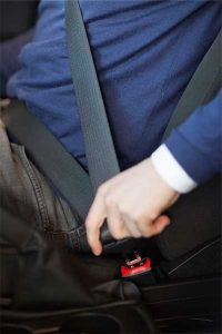 Photo of man fastening seat belt over his lap