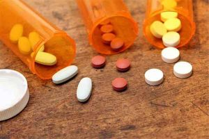 drug-related accidents- photo of pills spilling from prescription bottles